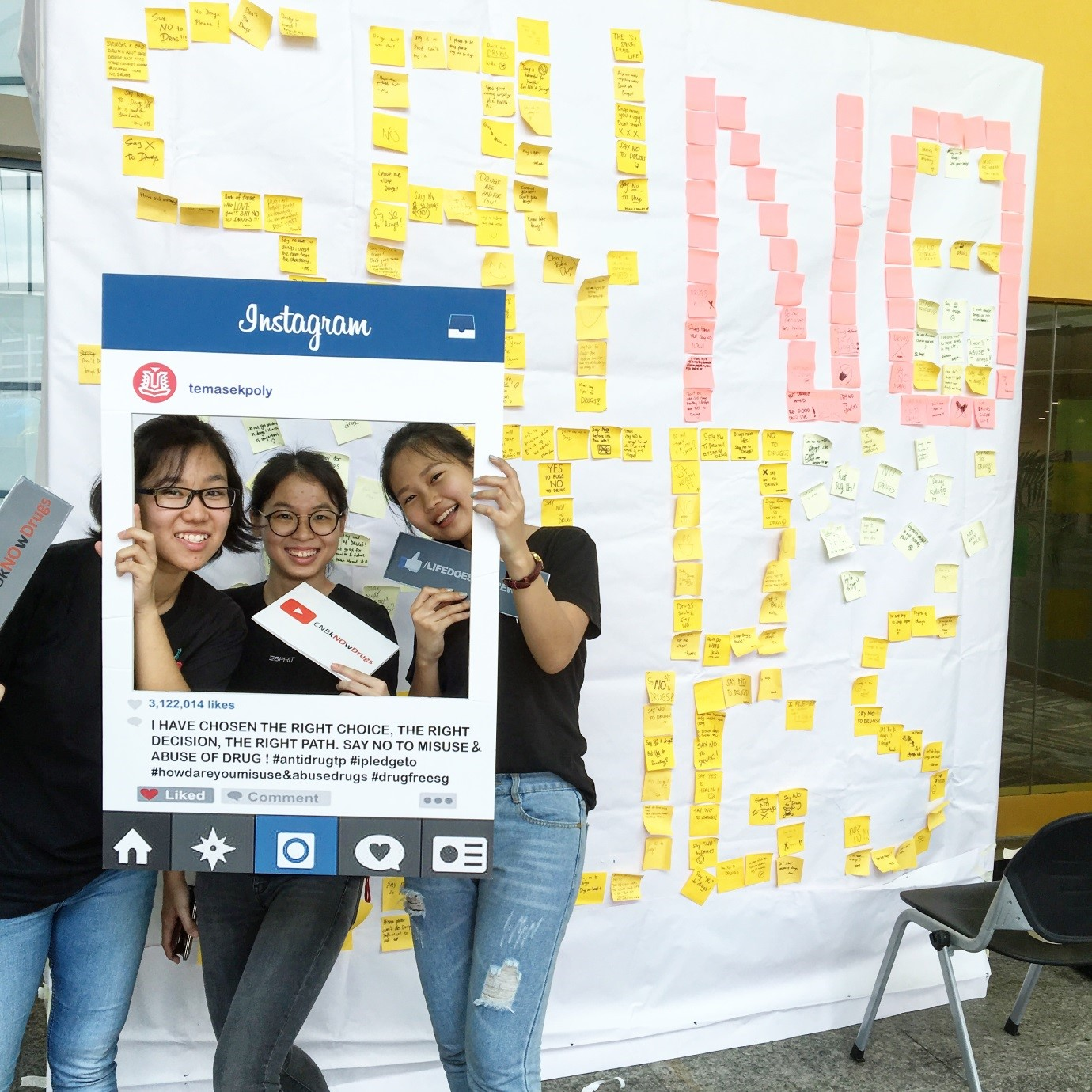Students posing with a prop for the anti-drug roadshow that they organised